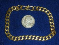 "A 24K bracelet, 39 grams with ""bending"" clasp."